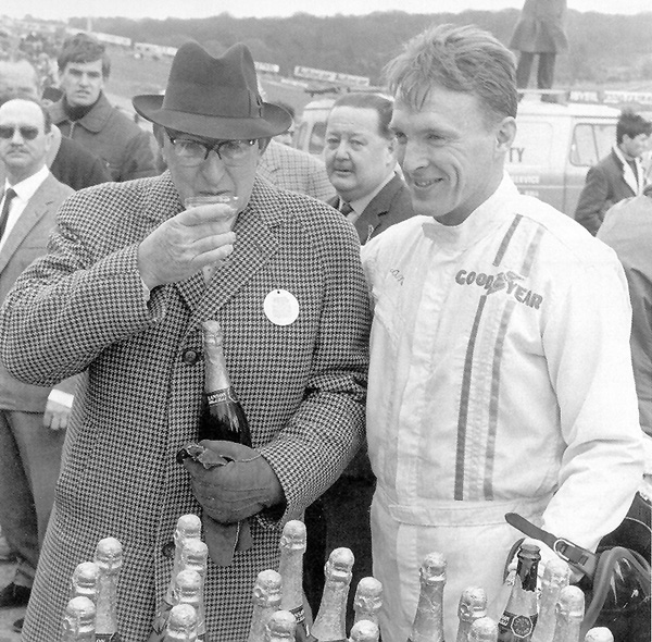 To the winners go the spoils: Dan wins 100 bottles of champagne at the Race of Champions, Brands Hatch 1967. Harry Weslake, Chairman of Weslake Engineering, takes the first and well-deserved sip. Photo: Courtesy Dan Gurney/All American Racers