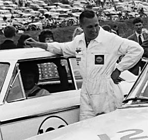 Brian Muir started with the John Willment Organization as a mechanic. He is seen here with Jack Sears who is preparing to drive the Willment Ford Galalxie at Brands Hatch on Aug. 5, 1963. Photo courtesy of Ford Motor Company.